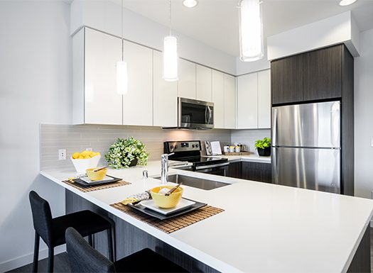 Bell Uptown District kitchen with white countertops and cabinets