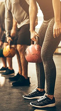 People exercising in class with kettlebells